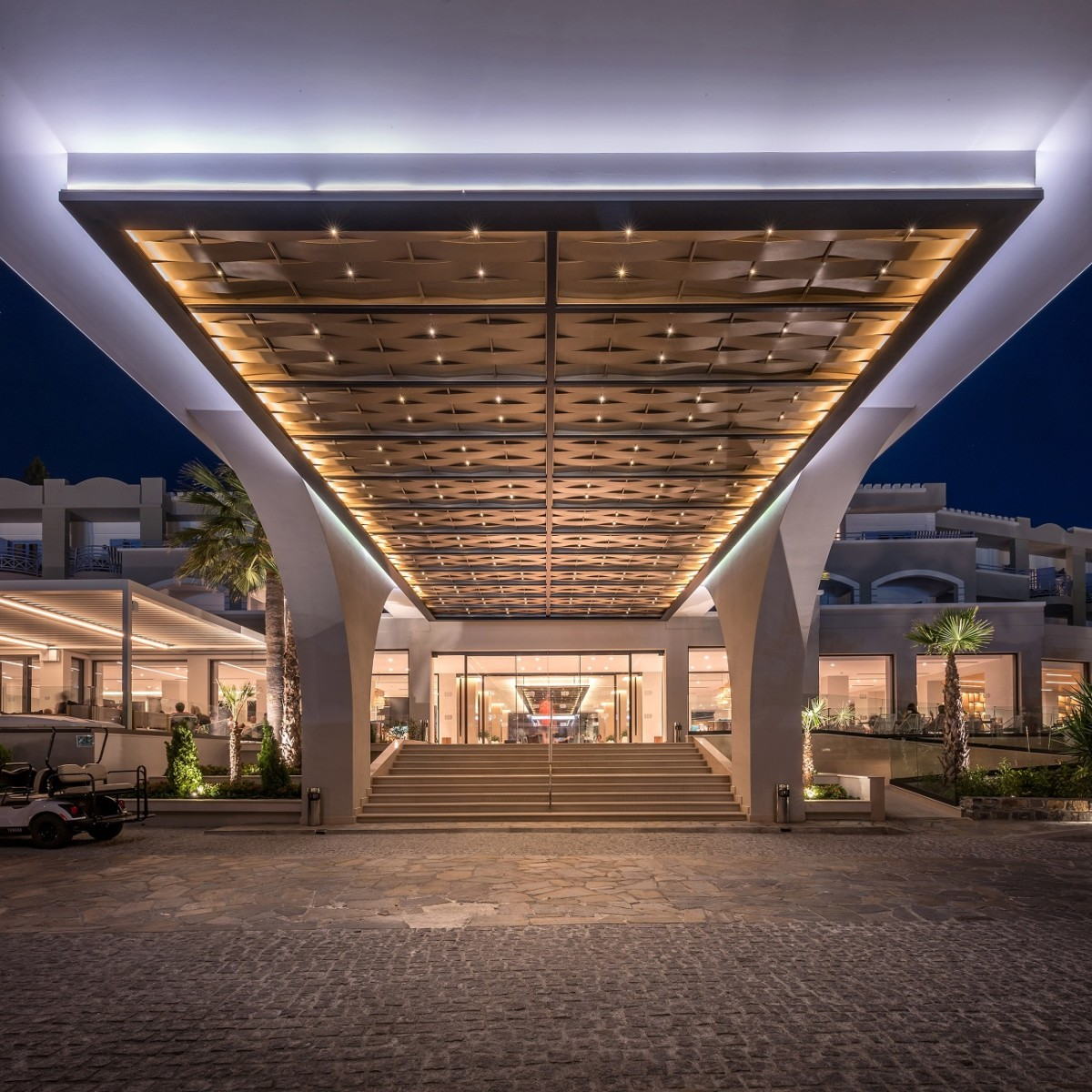 Revamping and interior design of mitsis rodos village for Hotel entrance decor